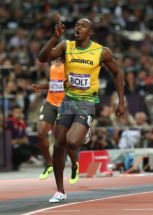 Usain Bolt of Jamaica celebrates after crossing the finish line to win the gold medal during the 100m final during track and field at the Olympic Stadium during day 9 of the London Olympic Games in London, England, United Kingdom on August 3, 2012..(Jed Jacobsohn/for The New York Times)..