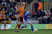 Ipswich Town striker Freddie Sears breaks away from Wolverhampton Wanderers midfielder George Saville during the Sky Bet Championship match between Wolverhampton Wanderers and Ipswich Town at Molineux, Wolverhampton, England on 2 April 2016. Photo by Alan Franklin.