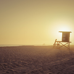 Lifeguard tower M Newport Beach CA sunset photo. Newport Beach is a popular coastal beach city in Orange County Southern California in the Western United States of America. Copyright ⓒ 2017 Paul Velgos with all rights reserved.