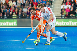 England's Chris Griffiths is watched by Robert Van Der Horst of the Netherlands. England v Netherlands  - Unibet EuroHockey Championships, Lee Valley Hockey & Tennis Centre, London, UK on 23 August 2015. Photo: Simon Parker