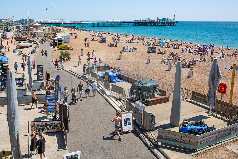 © Licensed to London News Pictures. 30/05/2020. Brighton, UK. Members of the public take to the beach in Brighton and Hove on the hottest day of the year so far.  Photo credit: Hugo Michiels/LNP
