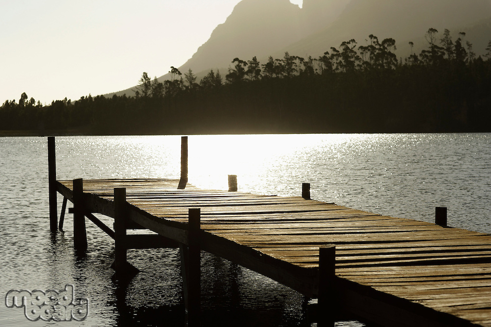 Wooden dock on lake.