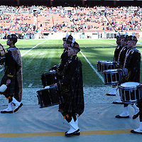 10 December 2011:   The Navy Fife and Drum corps take the field prior to the game against the Army Black Knights at Fed Ex field in Landover, Md. in the 112th annual Army Navy game where Navy defeated Army, 27-21 for the 10th consecutive time.