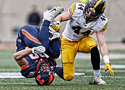 CHAMPAIGN, IL - NOVEMBER 19: Zach Grant #88 of the Illinois Fighting Illini cradles the ball in his legs that would eventually be called incomplete as Ben Niemann #44 of the Iowa Hawkeyes defends at Memorial Stadium on November 19, 2016 in Champaign, Illinois. (Photo by Michael Hickey/Getty Images) *** Local Caption *** Zach Grant; Ben Niemann