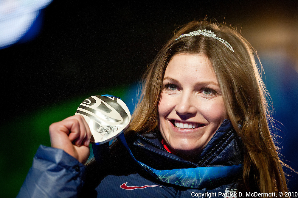 Julia Mancuso of the United States shows off her silver medal in the Women's Downhill at the 2010 Vancouver Winter Olympics in Whistler, British Columbia, Wednesday, Feb. 17, 2010.