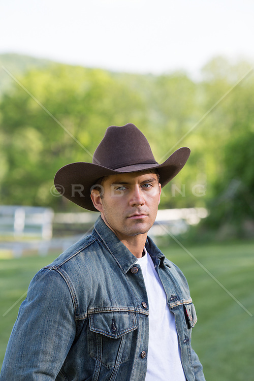 portrait of a rugged All American cowboy outdoors