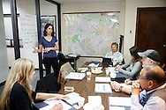 "Alexandra Nagy, an organizer with Food & Water Watch speaks about a plan to ""Shut It All Down"" as residents including Matt Pakucko, president and co-founder of Save Porter Ranch, center right, and Kyoko Hibino, rear right, look on, during a board meeting of the Save Porter Ranch as methane gas leaks from the SoCalGas Aliso Canyon Storage Facility well SS-25 in the Porter Ranch neighborhood of Los Angeles, California on Sunday, January 3, 2016. The Aliso Canyon gas leak (also called Porter Ranch gas leak) was a massive natural gas leak that started on October 23, 2015. According to Wikipedia, an estimated 1,000,000 barrels per day was released from a well within the underground storage facility in the Santa Susana Mountains near Porter Ranch. The second-largest gas storage facility it belongs to the Southern California Gas Company (SoCalGas), a subsidiary of Sempra Energy. On Jan. 6, 2016, Governor Jerry Brown issued a State of Emergency. The Aliso gas leak carbon footprint is said to be larger than the Deepwater Horizon leak in the Gulf of Mexico. On Feb. 11, 2016 the gas company reported that it had the leak under control. On Feb. 18 state officials announced that the leak was permanently plugged. An estimated 97,100 tonnes of methane and 7,300 tonnes of ethane was released into the atmosphere, making it the worst natural gas leak in U.S. history in terms of its environmental impact. © 2016 Patrick T. Fallon"