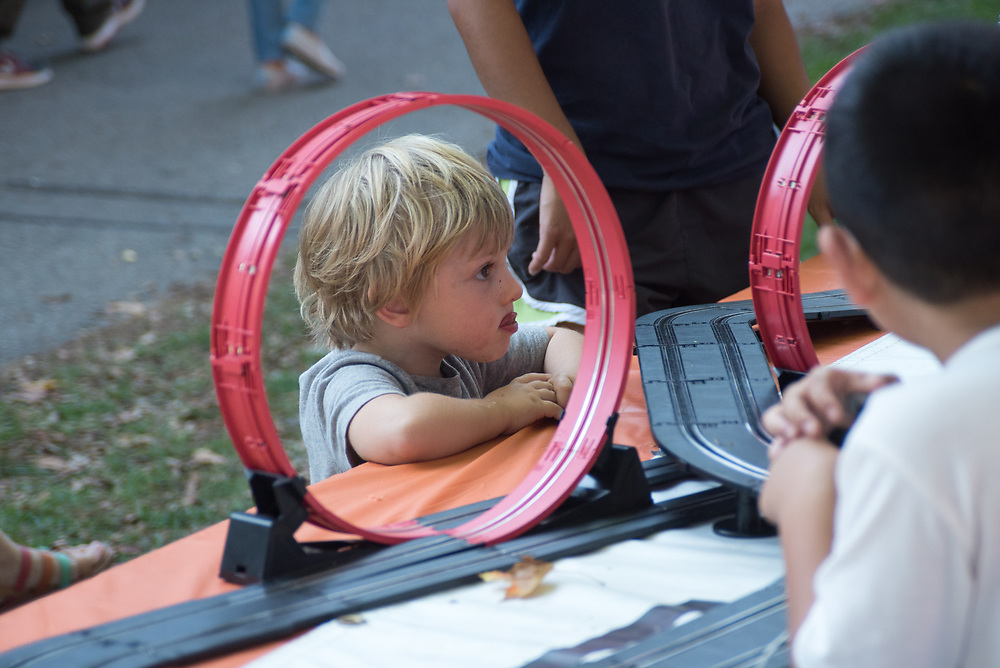 9/24/17 – Medford/Somerville, MA – Child fascinated by a mini-car track during Tufts Community Day on September 24. (Seohyun Shim / The Tufts Daily)