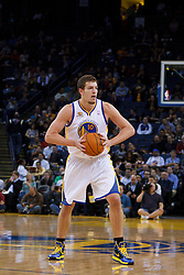 Jan 25, 2012; Oakland, CA, USA; Golden State Warriors power forward David Lee (10) holds the ball against the Portland Trail Blazers during the first quarter at Oracle Arena. Golden State defeated Portland 101-93. Mandatory Credit: Jason O. Watson-US PRESSWIRE