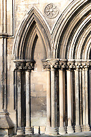 13th century Early English blind arcade adjacent to door in south transept of Beverley Minster with stiff leaf capitals and dogtooth moulding
