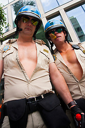"London, June 28th 2014. Two ""motorcycle cops"" pose for pictures as Gay Pride revellers assemble on Baker Street ahead of the parade."