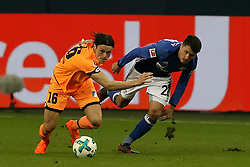 GELSENKIRCHEN, Feb. 18, 2018  Hoffenheim's Nico Schulz (L) and Schalke's Alessandro Schoepf vie for the ball during the German Bundesliga soccer match between FC Schalke 04 and Hoffenheim, in Gelsenkirchen, western Germany, on Feb. 17, 2018. Schalke won 2-1. (Credit Image: © Joachim Bywaletz/Xinhua via ZUMA Wire)