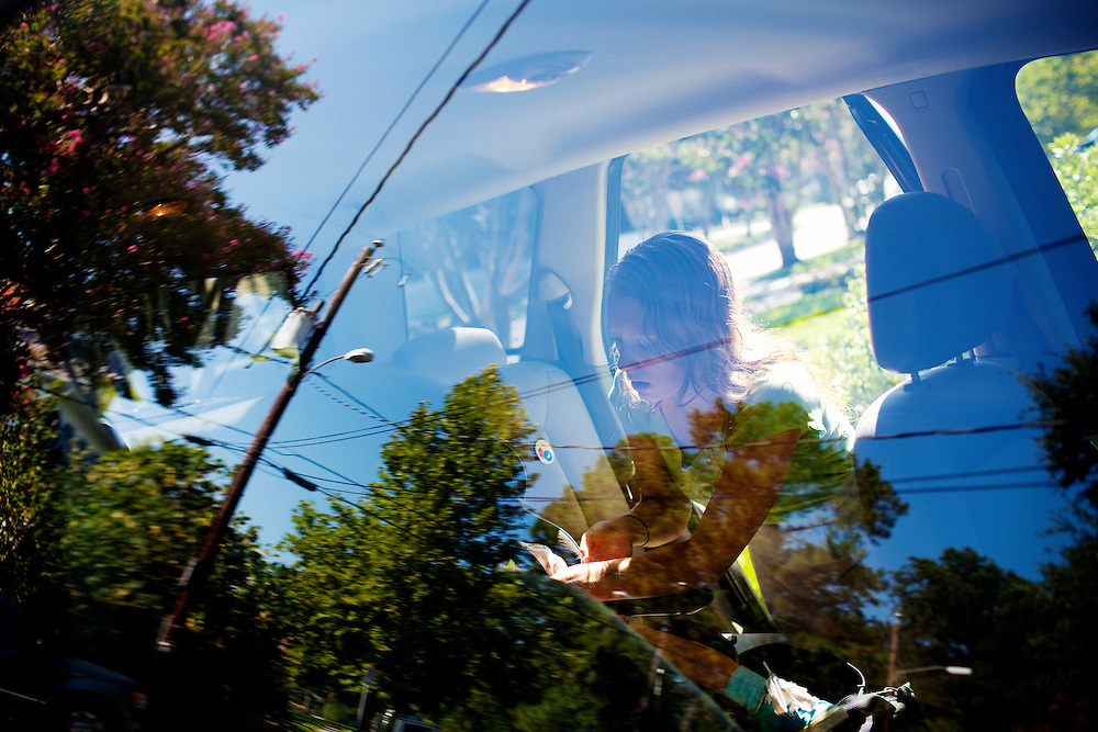 Melissa Eich, 23, loads her daughter Madelyn, 2, into her car seat in the morning before dropping her at daycare and going to class at Old Dominion University in Norfolk, Virginia on Thursday, July 22, 2010.