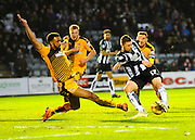 Cambridge Utd's Leon Legge slides in to block Plymouth Argyle's Ryan Brunt during the Sky Bet League 2 match between Plymouth Argyle and Cambridge United at Home Park, Plymouth, England on 12 December 2015. Photo by Graham Hunt.