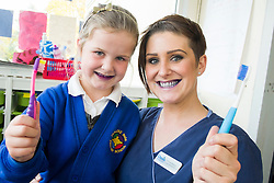 Oasis Lead Dental Nurse Mel Brown with Gracie after using  disclosure tablets to reveal plaque in the mouth during an oral hygiene session at  Hunloke Park Primary School Wingerworth Chesterfield on Tuesday<br /> 20 October 2015<br />  Image © Paul David Drabble <br />  www.pauldaviddrabble.co.uk