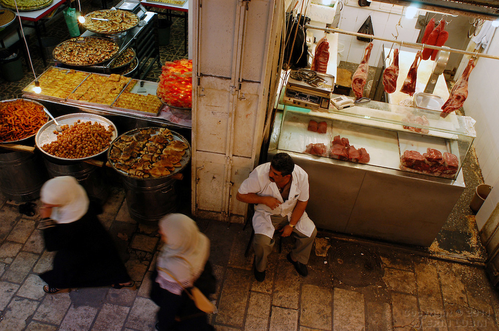 A butcher sits outside of his shop in the Old City of Jerusalem Monday afternoon, November 3, 2003. ..Photo by Erin Lubin