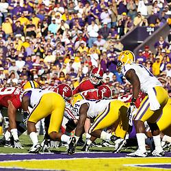 November 6, 2010; Baton Rouge, LA, USA; Alabama Crimson Tide quarterback Greg McElroy (12) under center against the LSU Tigers during the first half at Tiger Stadium.  Mandatory Credit: Derick E. Hingle