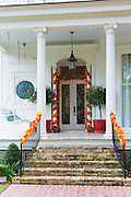 Traditional grand mansion house with columns, and festive decoration in the Garden District of New Orleans, Louisiana, USA