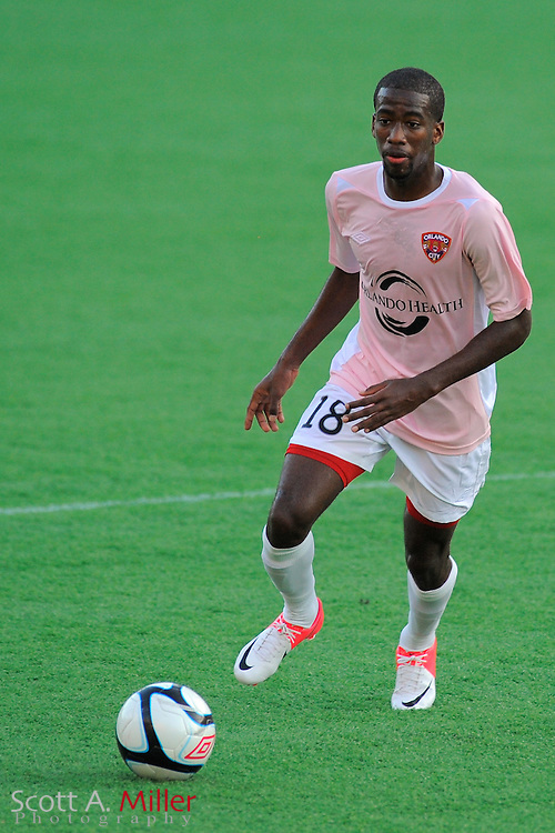 Orlando City Lions midfielder Kevin Molino (18) during the Lions 4-0 win over the Rochester Rhinos in a PSL-Pro game at the Citrus Bowl on July 14, 2012 in Orlando, Florida. ..©2012 Scott A. Miller