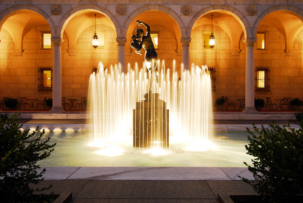 The Courtyard of the Boston Public Library at night. The Bacchante and Infant Faun statue by Frederick MacMonnies stands in the center.