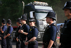 UK ENGLAND WEST SUSSEX BALCOMBE 26JUL13 - Police guard lorries exiting and entering the Cuadrilla hydraulic fracking drill site in Balcombe, West Sussex.<br /> <br /> Cuadrilla plans to start drilling a 3,000ft (914m) vertical well and a 2,500ft (762m) horizontal bore to the south of the village in search for oil and gas resources.<br /> <br /> jre/Photo by Jiri Rezac<br /> <br /> &copy; Jiri Rezac 2013