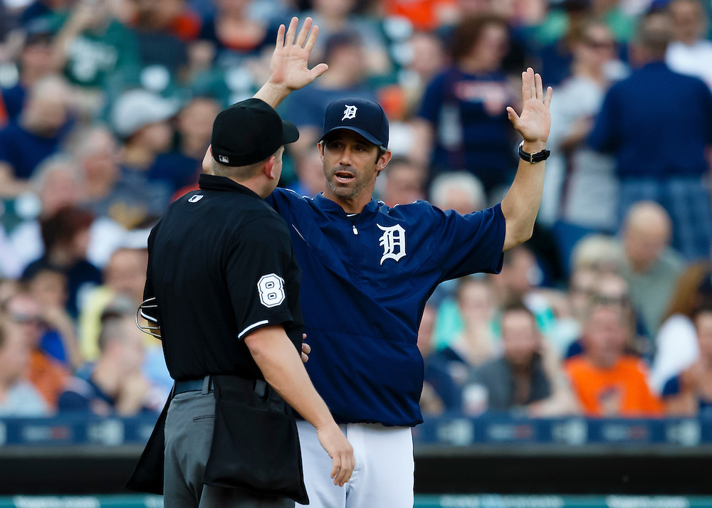 Jun 10, 2015; Detroit, MI, USA; Detroit Tigers manager Brad Ausmus (7) talks to umpires Clint Fagan in the second inning against the Chicago Cubs at Comerica Park. Mandatory Credit: Rick Osentoski-USA TODAY Sports