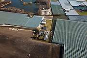 Nederland, Zuid-Holland, Westland, 20-03-2009; grond wordt bouwrijp gemaakt voor bouw nieuwe kassen, omgeving Naaldwijk (Gemeente 's-Gravezande). Air view on glasshouses and a construction site prepared to build new glasshouses on it.  Swart collectie, luchtfoto (toeslag); Swart Collection, aerial photo (additional fee required); .foto Siebe Swart / photo Siebe Swart