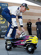 NASCAR driver Brad Keselowski rides the pole award after qualifying for Sunday's Sprint Cup Series auto race at Kansas Speedway in Kansas City, Kan., Friday, Oct. 16, 2015. (AP Photo/Colin E. Braley)