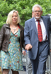 Image ©Licensed to i-Images Picture Agency. 27/06/2014.<br /> <br /> Rolf Harris arrives at Southwark Crown Court, London, UK with the support of his family.<br /> <br /> Pictured are Rolf's wife Bindi Nicholls and Rolf Harris arriving at court hand in hand.<br /> <br /> <br /> Picture by Ben Stevens / i-Images