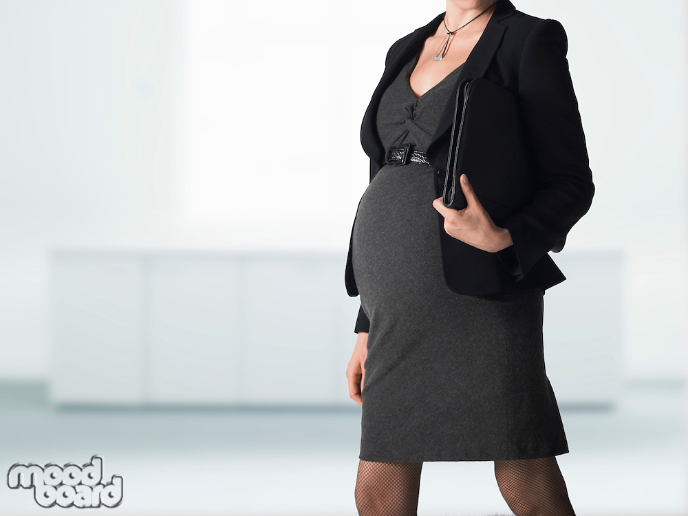 Pregnant businesswoman mid section