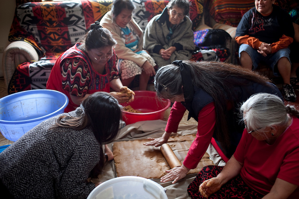 Tiah Honanie's clan relatives; her sisters, her aunties and her grandmothers make qomi for her engagement procession.  Qomi is ground sweet corn, sugar and water.