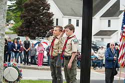 Boy Scouts Vincent Butka, left and Keith Cameron render their respect after placing a wreath on the Veterans' monument during Memorial Day services in Belmont on Monday, May 29, 2017.  (Alan MacRae for the Laconia Daily Sun)