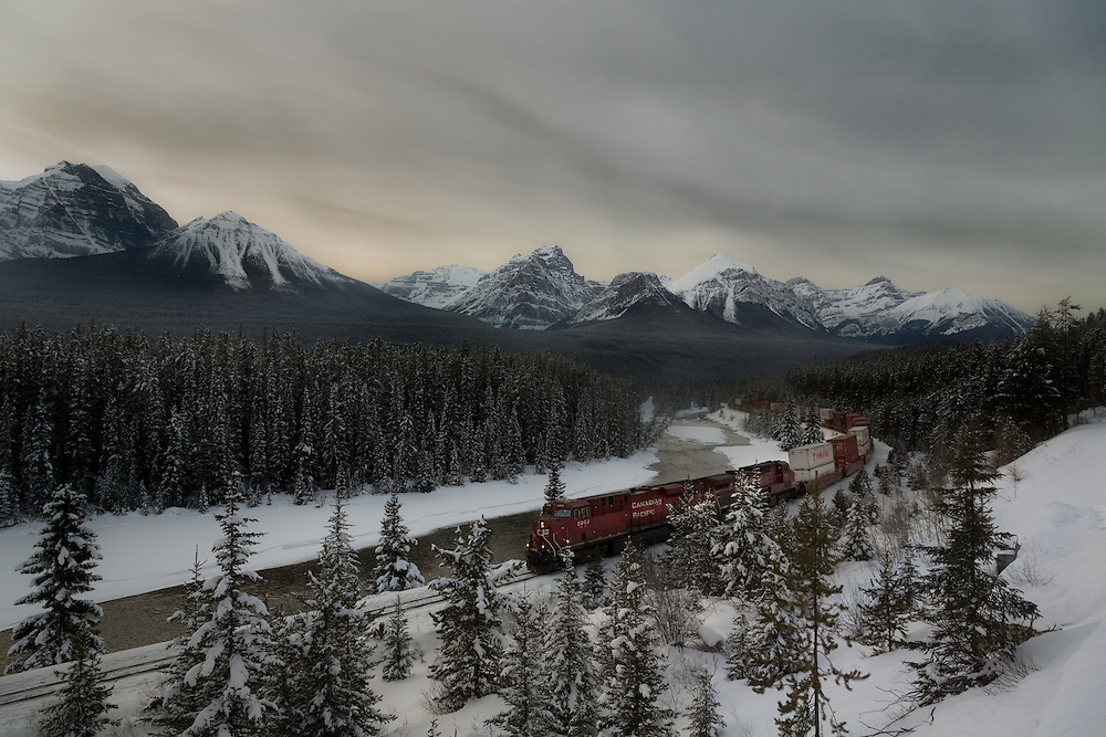Train passing through Morant's Curve along Bow Valley Parkway near Lake Louise, Banff National Park, Alberta, Canada