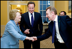 Former Prime Minister Baroness Thatcher with British Prime Minister David Cameron meets Michael York, who has worked in Number 10 since 1982, during her visit to Number 10 Downing Street, UK, Tuesday June 8, 2010. Photo By Andrew Parsons / i-Images.