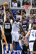 Dallas Mavericks power forward Elton Brand (42) gets his hand on San Antonio Spurs power forward Tiago Splitter's (22) layup during the first half at American Airlines Center in Dallas, Texas, on January 25, 2013.  (Stan Olszewski/The Dallas Morning News)
