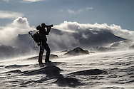Naturephotographer Kristoffer Ahlm fights the harsh weather while shooting the mountain Bitihorn in Norway.