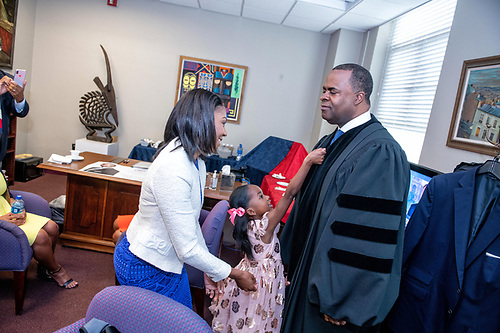 Kasim Reed, Mrs. Reed, and their daughter in the president
