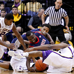 November 23, 2011; Baton Rouge, LA; LSU Tigers forward Storm Warren (24) and guard John Isaac (32) battle for a loose ball  with South Alabama Jaguars guard Xavier Roberson (3) during the first half of a game at the Pete Maravich Assembly Center.  Mandatory Credit: Derick E. Hingle-US PRESSWIRE
