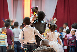 27 October 2019, Addis Ababa, Ethiopia: Children approach the altar for a moment of blessing during Sunday service at the Finfinne Oromo Mekane Yesus Congregation of the Ethiopian Evangelical Church Mekane Yesus. In a context where congregations did not use to be allowed to hold their services in any language but Amharic, the congregation today is one of some 60 Oromo speaking Mekane Yesus congregations in Addis Ababa. The service takes place on the first Sunday following political turmoil in the country, claiming dozens of lives.