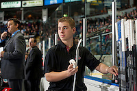 KELOWNA, CANADA - DECEMBER 5: Brendan Hait, equipment manager of the Kelowna Rockets, stands on the bench against the Prince George Cougars on December 5, 2014 at Prospera Place in Kelowna, British Columbia, Canada.  (Photo by Marissa Baecker/Shoot the Breeze)  *** Local Caption *** Brendan Hait;