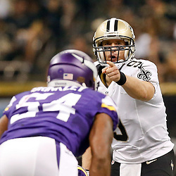 Sep 21, 2014; New Orleans, LA, USA; New Orleans Saints quarterback Drew Brees (9) signal at the line during the first quarter of a game against the Minnesota Vikings at Mercedes-Benz Superdome. Mandatory Credit: Derick E. Hingle-USA TODAY Sports
