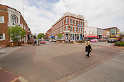 Cars and pedestrians travel through the intersection of North Main Street and West Central Ave. on Thursday, April 23, 2015, in Bentonville, Ark.<br /> <br /> Photo by Beth Hall