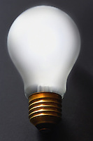 Light bulb on black background close-up