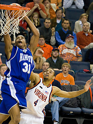 Hampton Pirates forward Donte Harrison (31) goes up for a dunk over Virginia guard Calvin Baker (4).  The Virginia Cavaliers men's basketball team defeated the Hampton Pirates 79-65 at the John Paul Jones Arena in Charlottesville, VA on December 19, 2007.