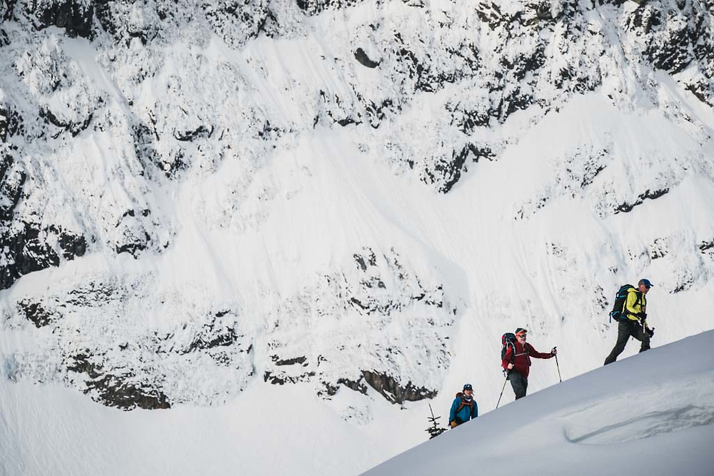Hank Wissenz, John Connolly, and Emily Bodner below the flanks of Hut Peak, Howson Range, British Columbia.
