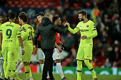 MANCHESTER, ENGLAND - Thursday, April 11, 2019: Manchester United's manager Ole Gunnar Solskjær (Solskjaer) (L) shakes hands with Barcelona's Gerard Piqué during the UEFA Champions League Quarter-Final 1st Leg match between Manchester United FC and FC Barcelona at Old Trafford. Barcelona won 1-0. (Pic by David Rawcliffe/Propaganda)