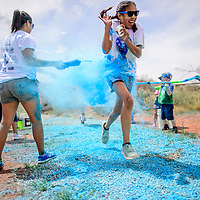 Students dash through colored dye during the 2018 Rehoboth Color run at Rehoboth April 27.