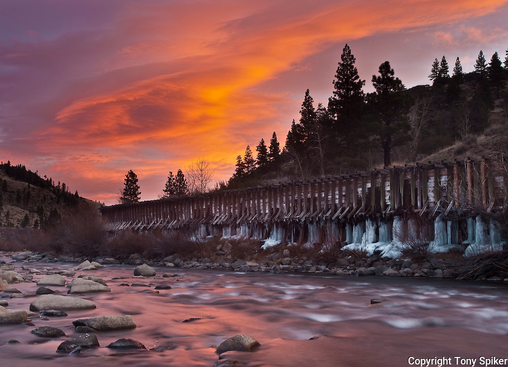 """""""Truckee River Sunrise 1"""" - A long exposure photograph of a winter sunrise over the Truckee River.  Icicles have formed underneath the flume in the picture."""