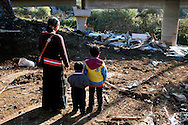 Roma  4 December 2007.Vacated Rom's camp  of Ponte Mammolo  inhabited by  Romanian Romani forced to leave the camp by the police.  Mother with children watching their house destroyed by the bulldozers of the municipality of Rome