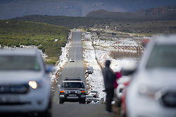 South Africa - Cape Town - 12 June 2020 - People park their cars and jump a fence to get to the snow. Snowfall is usually predicted at this time of year when the Western Cape Winter cold front hits hard. Snow covers the Matroosberg mountain ranges and high laying plateaus of Ceres including agricultural land. The snow attracts many visitors who enjoy themselves by building snowmen and throwing each other with snowballs. Despite South Africa being under level 3 lockdown, many people brought their families to marvel at the icy spectacle. Picture Courtney Africa/African News Agency(ANA)